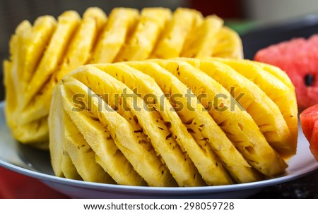 Pineapple juicy on the plate - stock photo