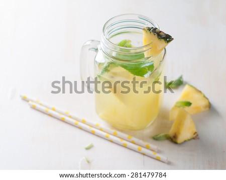 Pineapple lemonade with lemon and mint, selective focus - stock photo