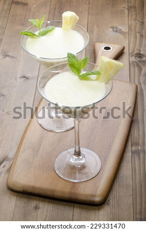 pineapple milkshake in a cocktail glass with mint  - stock photo