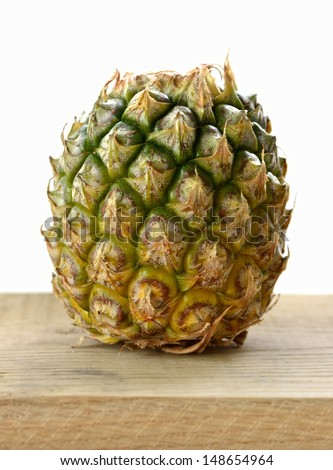 pineapple on a wooden cutting board