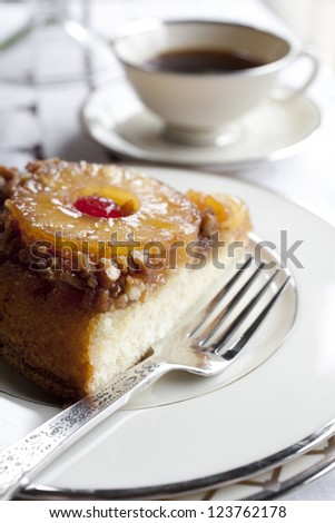 Pineapple Upside Down Cake Sliced and Served - stock photo