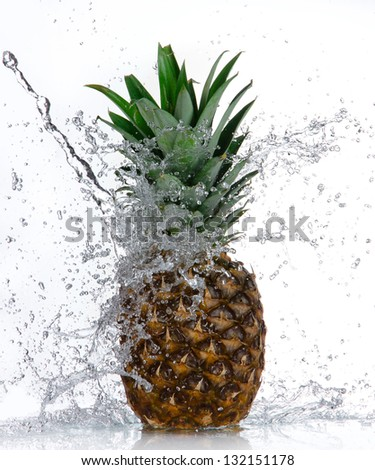 Pineapple with water splash isolated on white - stock photo
