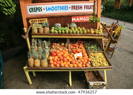 pineapples and other fruits for sale at a roadside stand on maui hawaii - stock photo