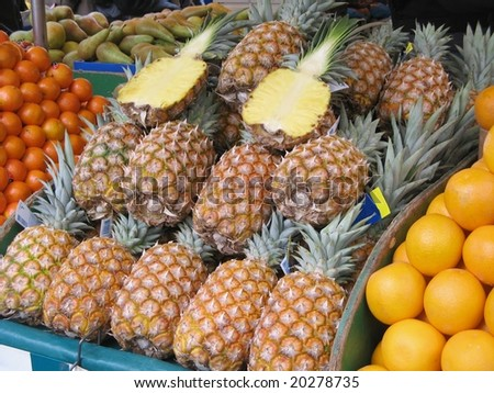 Pineapples at farmers market - stock photo