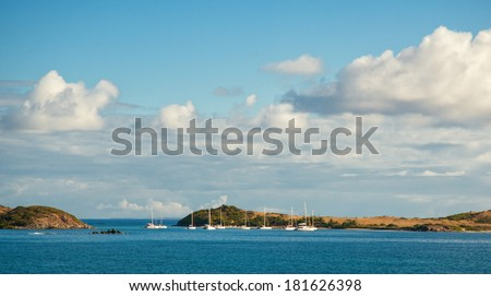 Pineli Island and Marina viewable from Orient beach, Saint Martin - stock photo