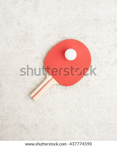Ping pong or table tennis paddle and ball.  - stock photo
