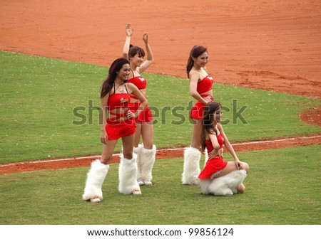 PINGTUNG, TAIWAN - APRIL 8: Cheerleaders encourage the fans of the President Lions who face the Lamigo Monkeys in a Pro Baseball League game. The Lions won 2:0 on April 8, 2012 in Pingtung, Taiwan - stock photo