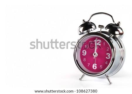 pink alarm clock isolated on white background - stock photo