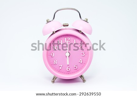pink alarm clock, six oclock - stock photo