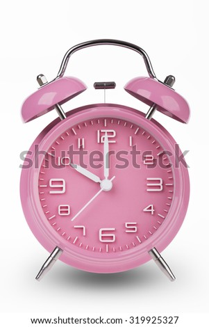 Pink alarm clock with the hands at 1 am or pm isolated on a white background.
