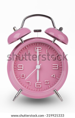 Pink alarm clock with the hands at 6 am or pm isolated on a white background.