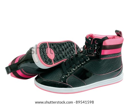 Pink and black sport shoes over a white bright background. - stock photo