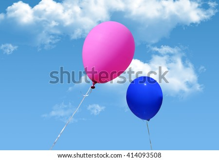 pink and blue balloons on a blue sky with white clouds