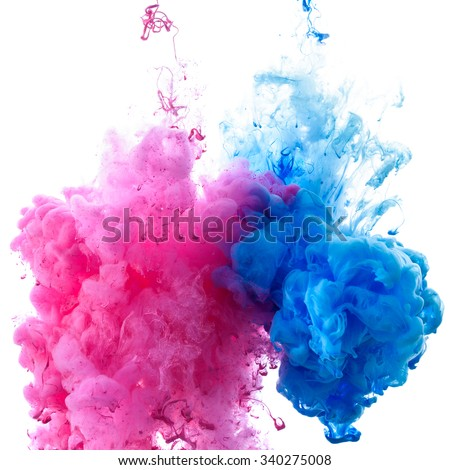 Pink and blue clouds of paint in water close-up