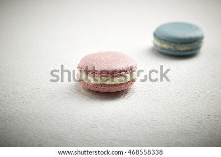 Pink and Blue Macaron on white paper Texture