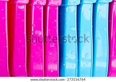 Pink and blue plastic tubs as a background image - stock photo