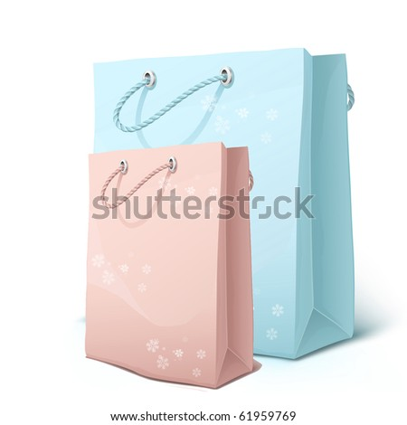 Pink and blue shopping bags with snowflakes isolated on white. - stock photo