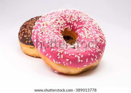 pink and brown donuts on white - stock photo