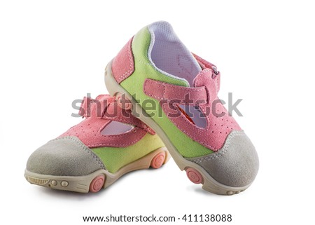 pink and green  baby shoes isolated on white