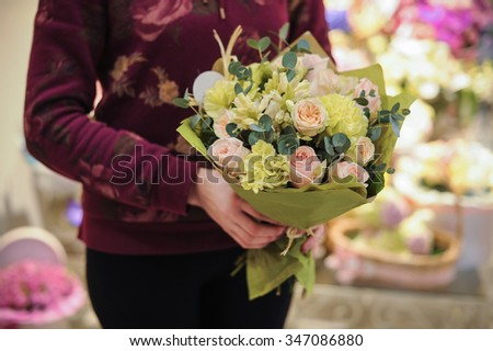 pink and green bouquet  with rose and other flowers in hands