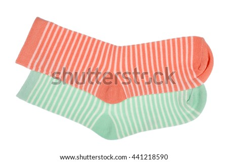 Pink and green striped childish socks isolated.