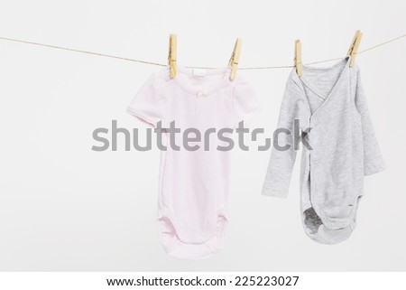 Pink and grey baby wear on washing line