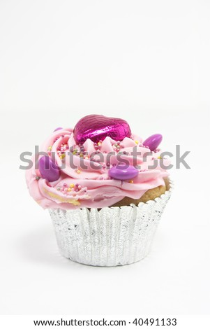 pink and hearts cupcake on a white background
