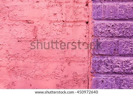 pink and purple brick wall - stock photo