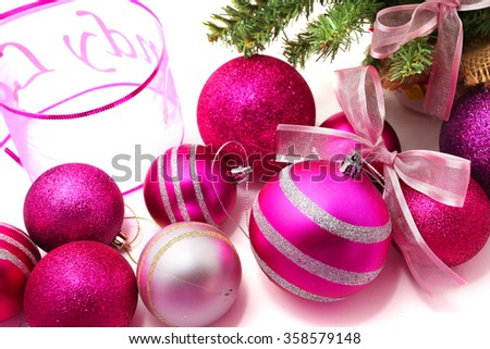 Pink and purple Christmas baubles with a Christmas tree and ribbon - stock photo