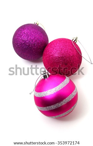 Pink and purple Christmas baubles with a Christmas tree isolated on white - stock photo