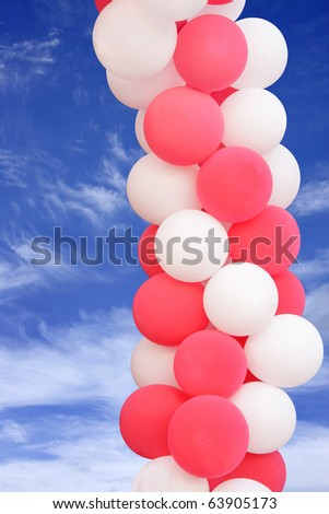 Pink and white balloons on blue sky - stock photo
