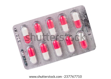 Pink and white capsule in blister pack - stock photo