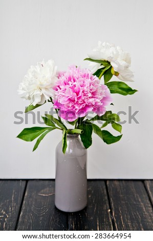 Pink and white peonies in a vase