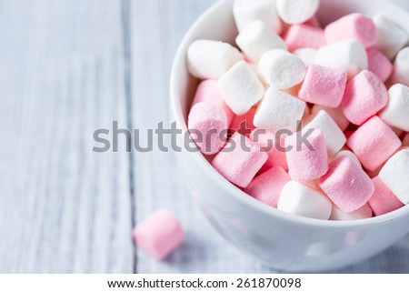 Pink and white sweet marshmallows on white background - stock photo