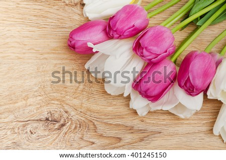 Pink and white tulip flowers on the vintage old wooden panel. Mothers day, Valentines day, Easter. - stock photo
