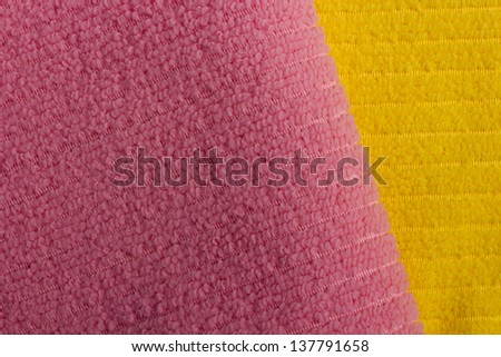 Pink and yellow terry towels as a background. - stock photo