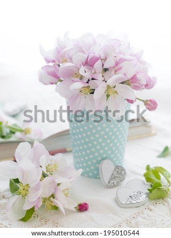 Pink apple blossom in dotted glass for celebration, selective focus  - stock photo