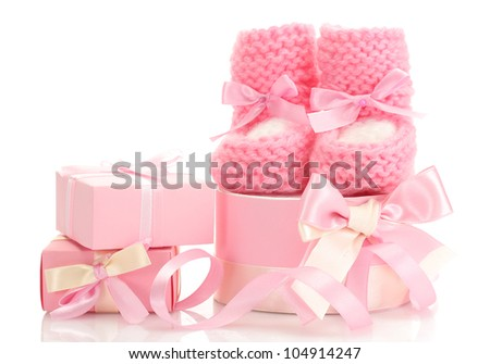 pink baby boots and gifts isolated on white