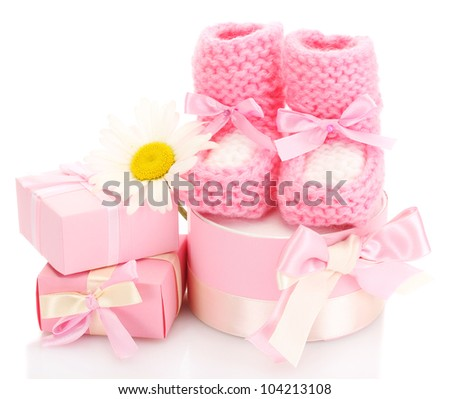 pink baby boots, gifts and flower isolated on white - stock photo