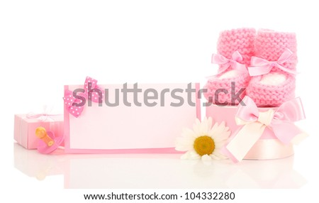 pink baby boots, pacifier, gifts, blank postcard and flower isolated on white - stock photo
