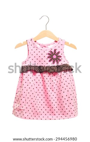 Pink baby clothes dress bodysuit polka dots texture with brown ruff back view in clothes hanger, isolated on white background. - stock photo