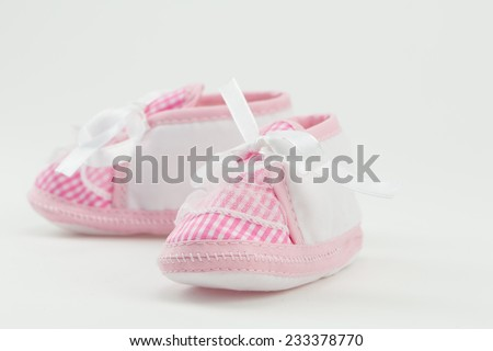 Pink baby's shoes/boots on white background