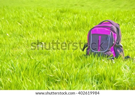 pink backpack on meadow - stock photo