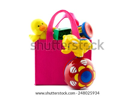 pink bag filled with baby toys isolated - stock photo