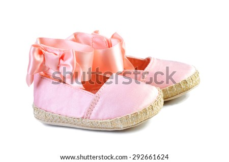pink ballerina shoe for a little girl, close-up isolated on white