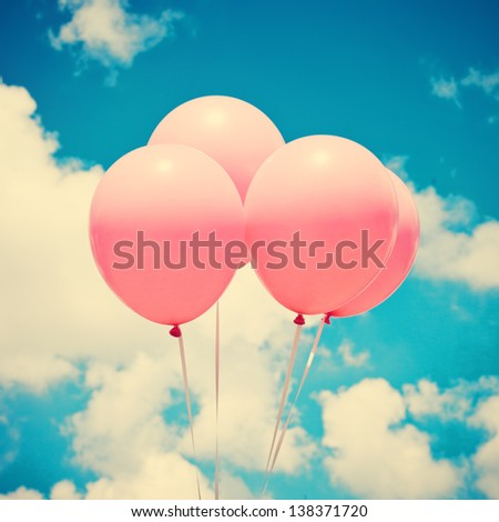Pink Balloons on Retro Vintage Sky - stock photo
