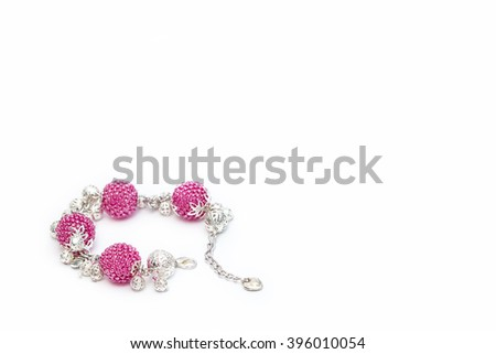 Pink beaded bracelet in the left corner - stock photo