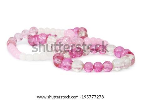 Pink Beaded Bracelets / Pink Beaded Bracelets, Isolated on White Background - stock photo