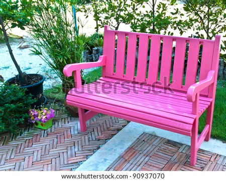 Pink bench in garden - stock photo
