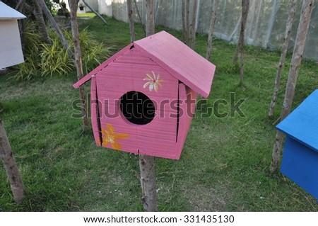 pink bird box,  bird house - stock photo